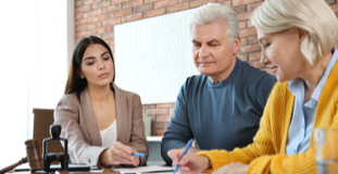 Older couple filing bankruptcy paperwork with a Licensed Insolvency Trustee